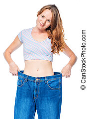 Vertical portrait of a lost weight girl after a diet in...
