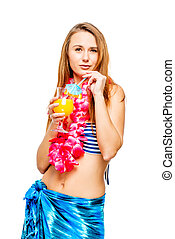 Brunette with a glass of cocktail at an Hawaiian party in...
