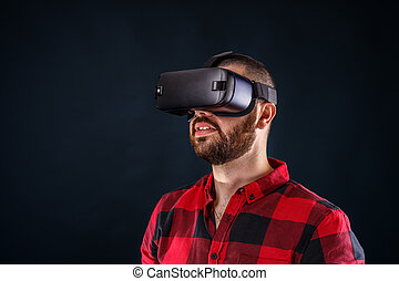 Man wearing virtual reality glasses
