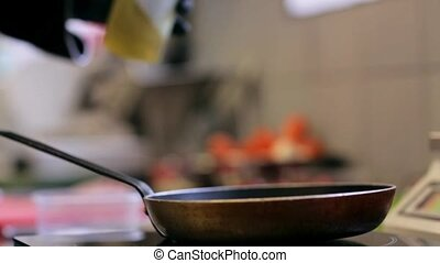 hands of chef with frying pan cooking in kitchen - cooking,...