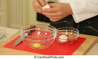 Breaking and whipping chicken eggs - Chef is breaking and...