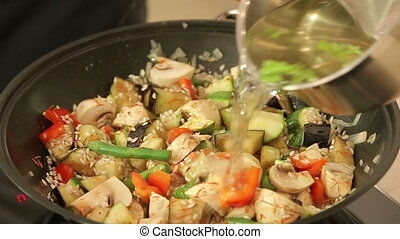 Stewing vegetables in a wok