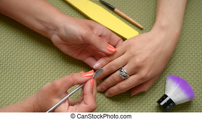 Cosmetologist making preparations for manicure. Hands woman...