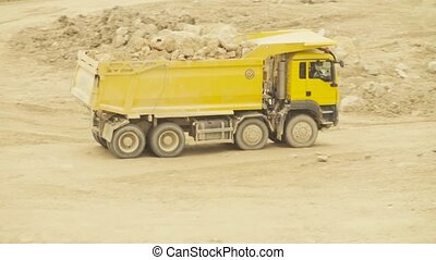 Truck on a road in quarry carring stones - Truck carring...