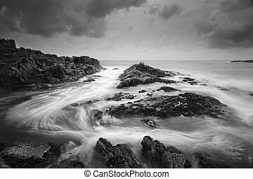Seascape with moody weather and swirling ocean flows -...