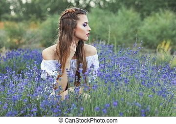 Woman among the blue wildflowers. - Portrait of a woman...