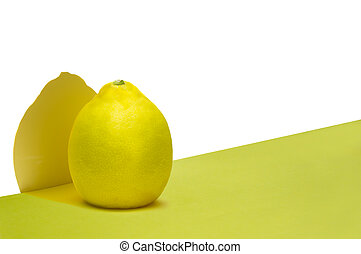 Lemon over white and yellow background with shadow