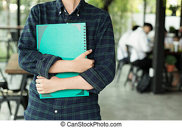 Young student holding notebook