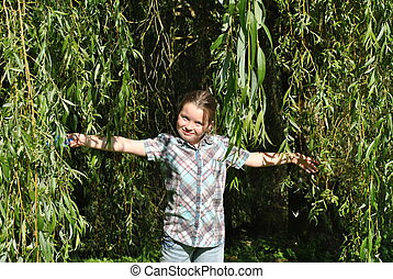beautiful child under a willow tree
