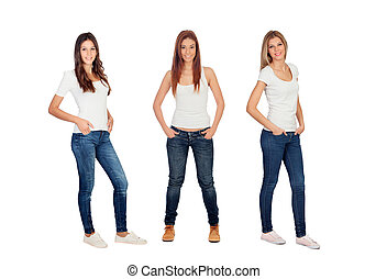 Full portrait of three casual girls with jeans and white...
