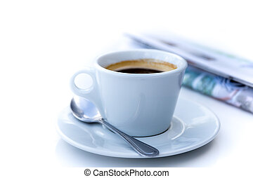 Cup of coffee in morning with newspaper