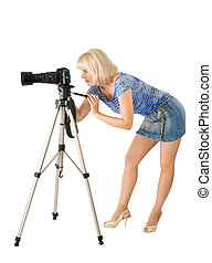 The lady - photographer is photographed on the white...