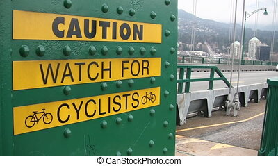 Caution watch for cyclists. - Handheld shot of %u2018Caution...