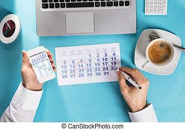 Businessman Marking Schedule On Calendar Using Gantt Chart -...