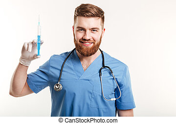 Portrait of a smiling happy medical doctor or nurse holding...