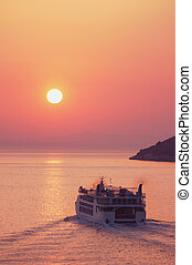 Ferry at Sunset - A ferry heads towards the sunset.