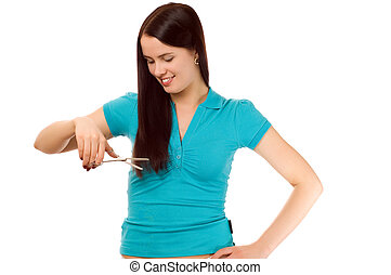 Young brunette with scissors cutting hair (isolated on white)