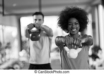 couple  workout with weights at  crossfit gym