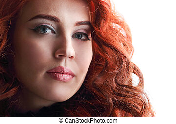 Beautiful young woman with curly red hair and bright makeup on white background