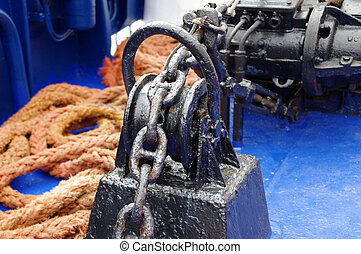 Anchor winch - Black painted anchor winch on ship