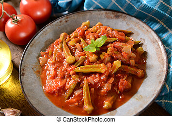 Okra dish with tomatoes (Traditional greek, romanian,...
