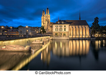 Grossmunster Church and Limmat River in the Evening, Zurich,...