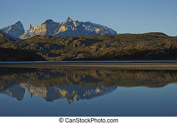 Mountain reflections in Patagonia - Mountain peaks of...