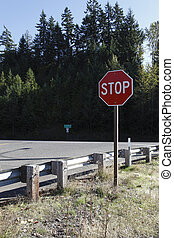Stop on 58 - A stop sign halts traffic before entering route...