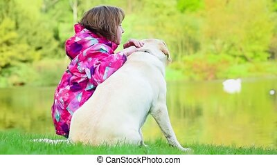 Girl with labrador retriever dog