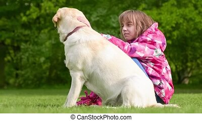Girl with labrador retriever dog - Little girl with labrador...