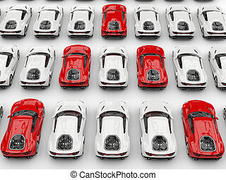 Red sports cars in formation amongst white cars - top down view