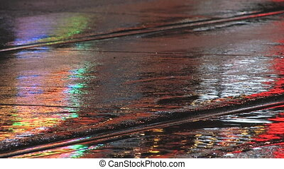 Wet city street at night - Wet city street with streetcar...