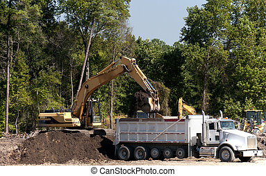 Industrial Excavator - An industrial excavator filling up a...