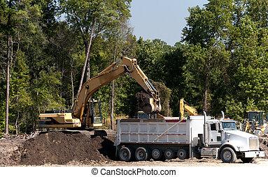 Industrial Excavator - An industrial excavator filling up a...