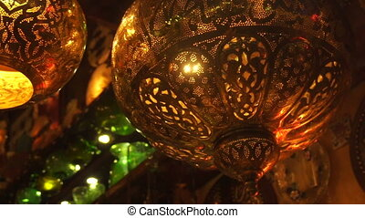 metallic bright bulbs with a pattern - close up of metallic...