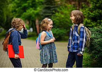 Pupils of elementary school about something cheerfully talk...