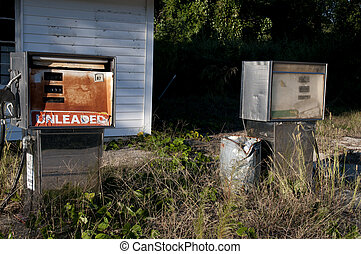Gas Crisis - Run down gas pumps at an abandoned petrol...