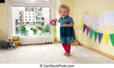 Hyperactive girl have fun. Active funny child at home.