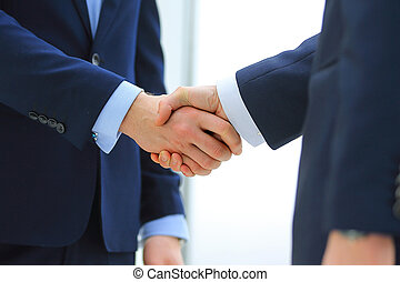 handshake of two businessmen in office