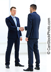 handshake of two businessmen in office - Business colleagues...