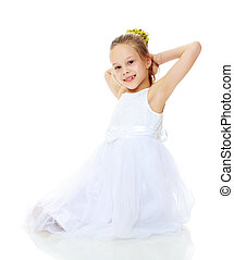 Beautiful little girl in a white dress - Beautiful Caucasian...