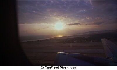Plane Flies Towards Sunrise Over Beautiful Landscape - huge...