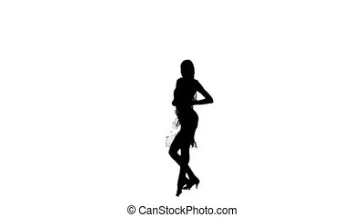 Solo woman is dancing elements of ballroom dancing. Silhouette, studio