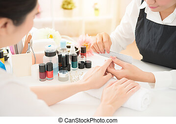 close up of manicurist doing nail mill