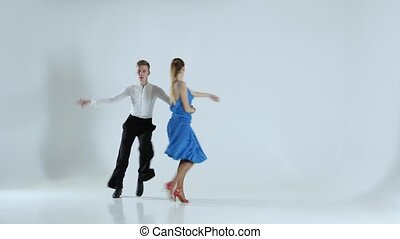 Couple of graceful dancers perform ballroom on white...