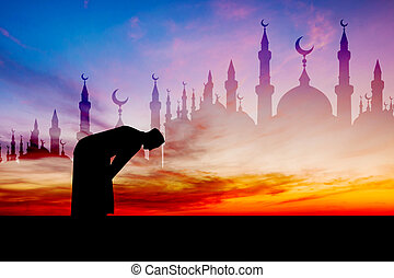 Islamic man praying Muslim Prayer in Twilight time