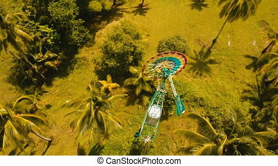 Small wind turbine in farm fields. Philippines, Siargao. -...