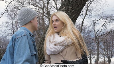 Sexy beautiful blonde arguing with her boyfriend on a date....
