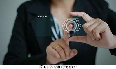 Hands of business woman using screen hologram technology and...