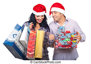 Satisfied Christmas couple of  their purchasing things